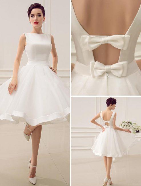 Короткое свадебное платье, украшенное бантами