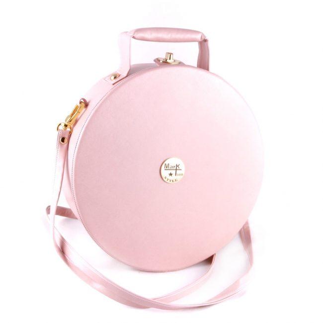 Круглая розовая сумка