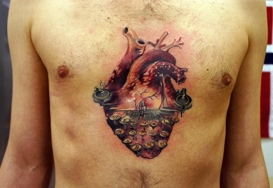 Наколка в стиле анатомический реализм на мужской груди