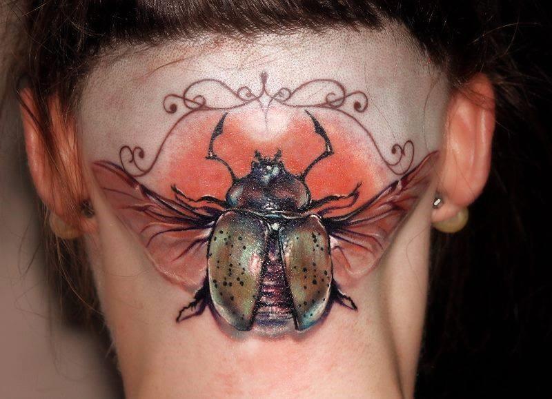 Тату жук скарабей на шее