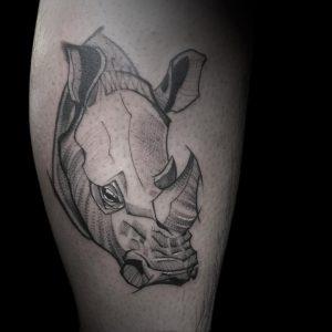 Тату с носорогом